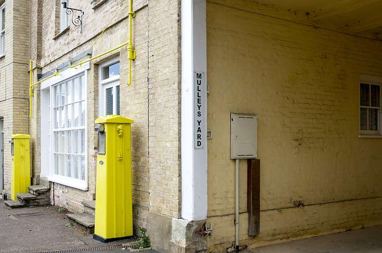 yellow petrol pumps